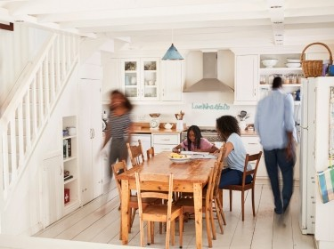 Busy family morning in the kitchen, photo by monkeybusinessimages/Getty Images