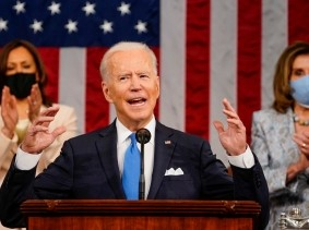 President Joe Biden addresses a joint session of Congress, with Vice President Kamala Harris and House Speaker Nancy Pelosi behind him, Washington, D.C., April 28, 2021, photo by Melina Mara/Reuters