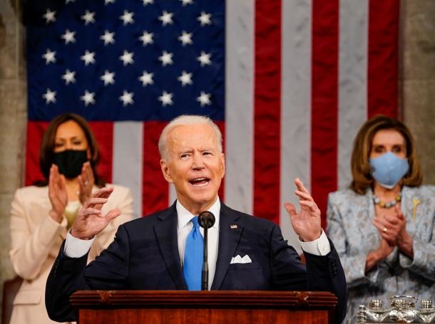 President Joe Biden addresses a joint session of Congress, with Vice President Kamala Harris and House Speaker Nancy Pelosi behind him, Washington, D.C., April 28, 2021, photo by Melina Mara/Reuters