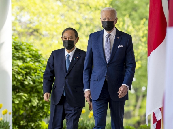 Prime Minister of Japan Yoshihide Suga and U.S. President Joe Biden walk on the Colonnade prior to their joint news conference at the White House in Washington, D.C., April 16, 2021, photo by Doug Mills/Pool via CNP/InStar