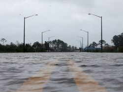A flooded road during Hurricane Sally in Gulf Shores, Alabama, September 16, 2020, photo by Jonathan Bachman/Reuters