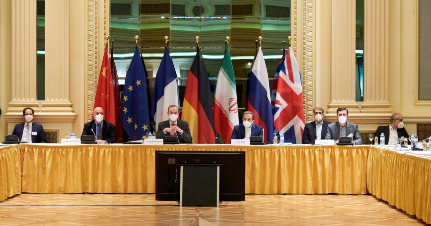 European External Action Service (EEAS) Deputy Secretary General Enrique Mora and Iranian Deputy at Ministry of Foreign Affairs Abbas Araghchi wait for the start of a meeting of the JCPOA Joint Commission in Vienna, Austria April 6, 2021