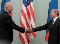 Joe Biden shakes hands with Vladimir Putin during a meeting in Moscow, Russia, March 10, 2011, photo by Alexander Natruskin/Reuters