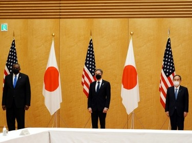 U.S. Secretary of State Antony Blinken and Defense Secretary Lloyd Austin meet with Japanese Prime Minister Yoshihide Suga at the Prime Minister's office in Tokyo, Japan, March 16, 2021, photo by Eugene Hoshiko/Pool via Reuters
