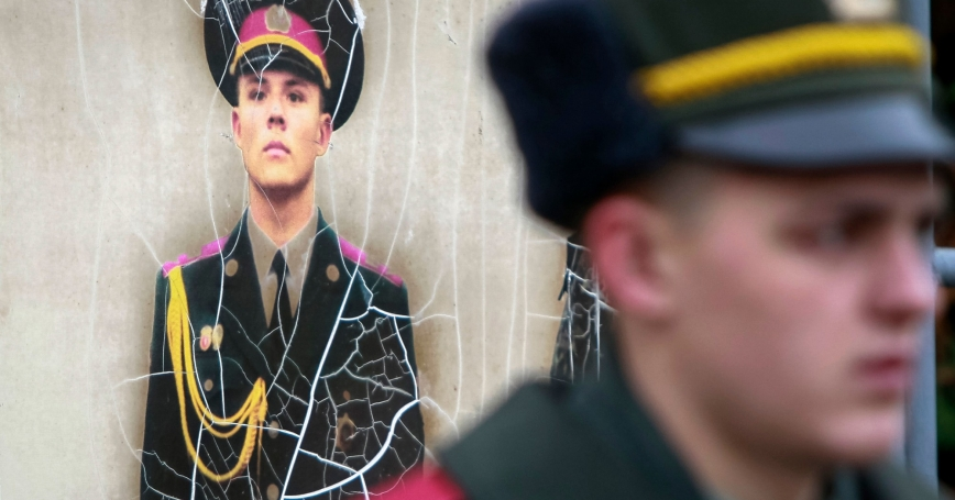 A recruit from the presidential regiment waits for a ceremony to take the oath at a military base in Kiev, Ukraine, November 16, 2013, photo by Gleb Garanich/Reuters
