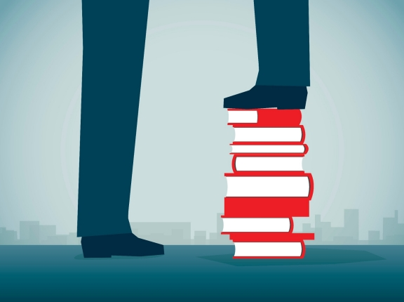 Illustration of two pairs of legs and feet with one on a stack of books, photo by erhui1979/Getty Images