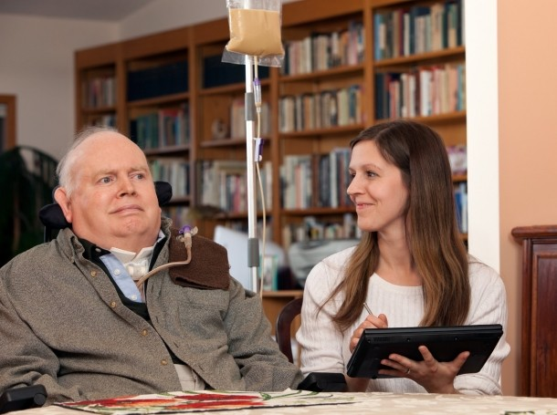 Man with MS with his caregiver, photo by BanksPhotos/Getty Images