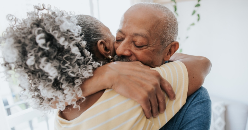 Senior couple embracing and smiling, photo by andreswd/Getty Images