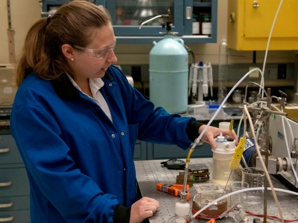 Naval Research Lab Chemical Engineer Katherine Hinnant prepares to test an experimental aqueous film-forming foam to replace firefighting foams containing fluorine at the NRL in Washington, Sept. 23, 2019, photo by Navy Petty Officer 3rd Class Manuel Najera/U.S. Department of Defense