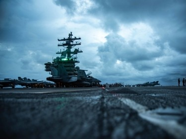 Sailors conduct flight operations on the flight deck of the aircraft carrier USS <em>Ronald Reagan</em>, in the South China Sea, June 14, 2021, photo by Petty Officer 3rd Class Quinton Lee/U.S. Navy