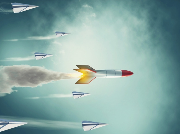 Paper plane race against a rocket missile, photo by ALLVISIONN/Getty Images