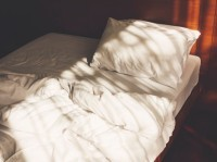 An empty, unmade bed