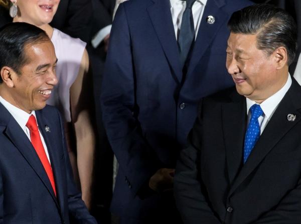Indonesia's President Joko Widodo speaks to China's President Xi Jinping at the G-20 summit, in Osaka, Japan, June 28, 2019, photo by Tomohiro Ohsumi/Pool via Reuters