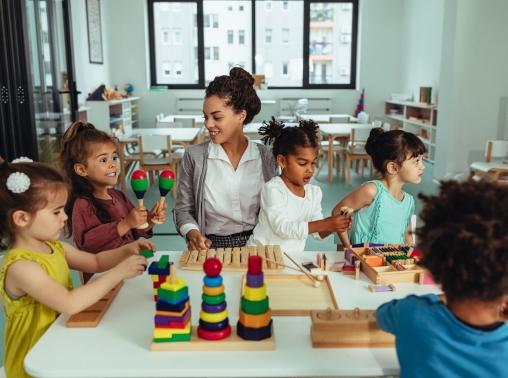Teacher and children in a preschool classroom, photo by bernardbodo/Getty Images