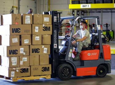 North Carolina Air National Guard Airman Staff Sgt. Jay Benton transports equipment with a fork-lift at a warehouse in western North Carolina, June 18, 2020, photo by Sgt. Marcel Pugh/U.S. Army