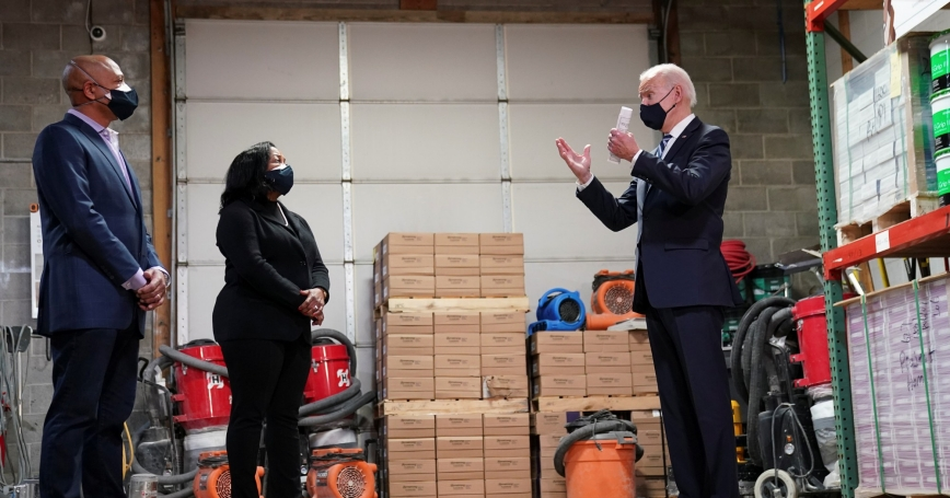 President Joe Biden speaks with Smith Flooring owners James and Kristin Smith at an event highlighting the $1.9 trillion American Rescue Plan Act in Chester, Pennsylvania, March 16, 2021, photo by Kevin Lamarque/Reuters