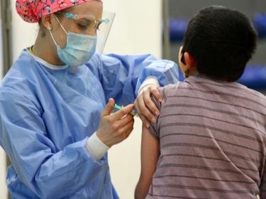 A person getting a COVID-19 vaccine in Santiago de Chile, Chile, on August 25, 2020, photo by Rodrigo Balladares/Handout/Reuters