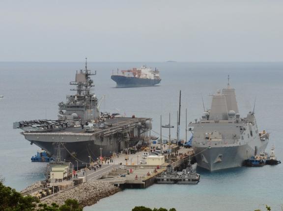 The USS <em>Bonhomme Richard</em>, left, and USS <em>Green Bay</em> docked at White Beach Naval Facility, Okinawa, Japan, March 5, 2015, photo by Lt. David Levy/U.S. Navy