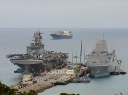 The USS Bonhomme Richard , left, and USS Green Bay docked at White Beach Naval Facility, Okinawa, Japan, March 5, 2015, photo by Lt. David Levy/U.S. Navy