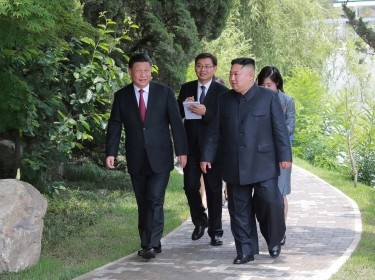 Chinese President Xi Jinping and North Korean leader Kim Jong-un take a walk in Pyongyang, North Korea, in this picture released by KCNA on June 21, 2019, photo by KCNA via Reuters