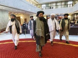 Mullah Abdul Ghani Baradar and other Taliban delegation members attend the Afghan peace conference in Moscow, Russia, March 18, 2021, photo by Alexander Zemlianichenko/Pool via Reuters