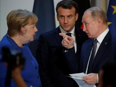Russian President Vladimir Putin, French President Emmanuel Macron, and German Chancellor Angela Merkel at a summit in Paris, France, December 10, 2019, photo by Charles Platiau/Pool via Reuters