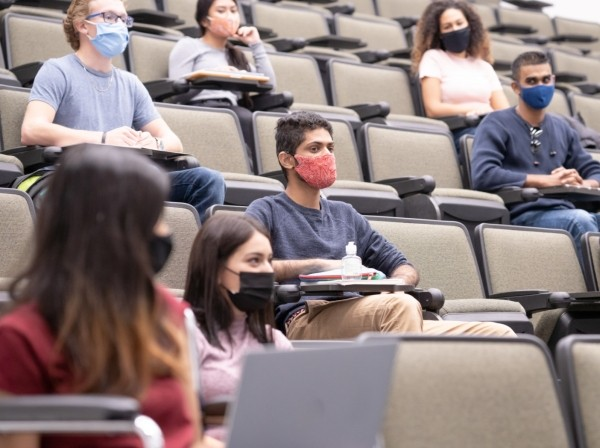 College students in a lecture hall with face masks, photo by FatCamera/Getty Images