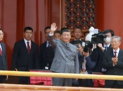 Chinese President Xi Jinping waves at an event marking the 100th founding anniversary of the CCP, in Tiananmen Square, in Beijing, China, July 1, 2021, photo by Carlos Garcia Rawlins/Reuters