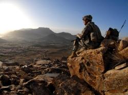 U.S. Army Sgt. Robert Newman watches the sunrise after a patrol mission near Zabul, Afghanistan, March 19, 2009, photo by Staff Sgt. Adam Mancini/U.S. Army