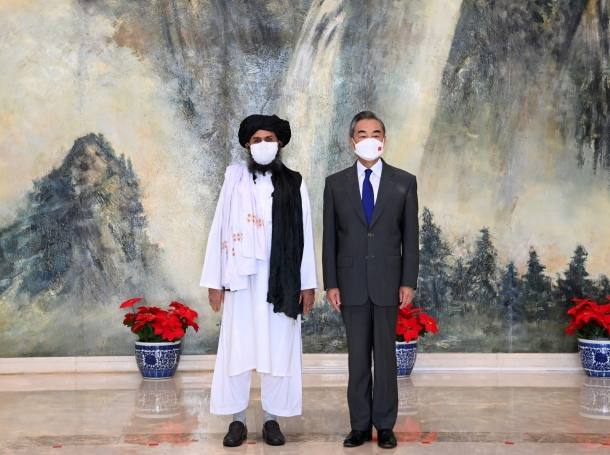 Chinese State Councilor and Foreign Minister Wang Yi meets with Mullah Abdul Ghani Baradar, political chief of the Taliban, in Tianjin, China, July 28, 2021, photo by Li Ran/Xinhua via Reuters