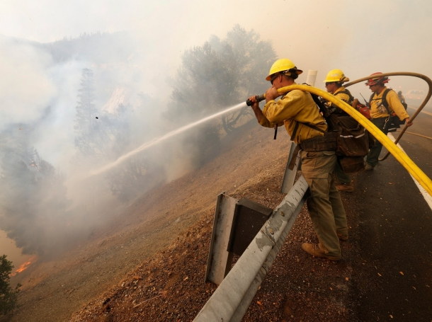 Firefighters knock down hot spots while protecting a rail bridge from the Dixie Fire near the town of Quincy, California, August 5, 2021, photo by Fred Greaves/Reuters