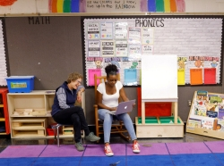 Kindergarten teacher Princess Bryant (R) and paraprofessional Emily Lichtenstein meet their incoming students and parents remotely before the first day of classes in the new school year at the Tynan Elementary School in Boston, Massachusetts, September 18, 2020, photo by Brian Snyder/Reuters