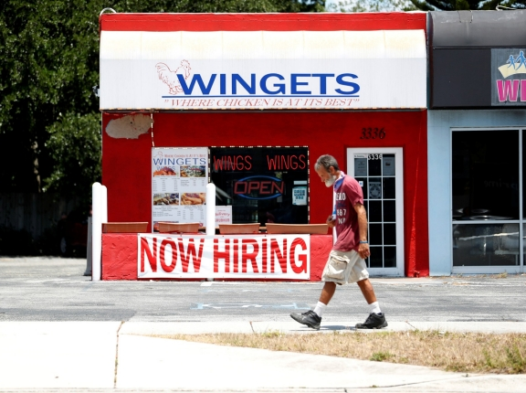 """A Wingets restaurant displays a """"Now Hiring"""" sign in Tampa, Florida, June 1, 2021, photo by Octavio Jones/Reuters"""