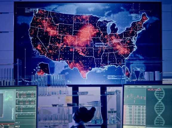 Laboratory with map of United States showing disease outbreaks, photo by janiecbros/Getty Images