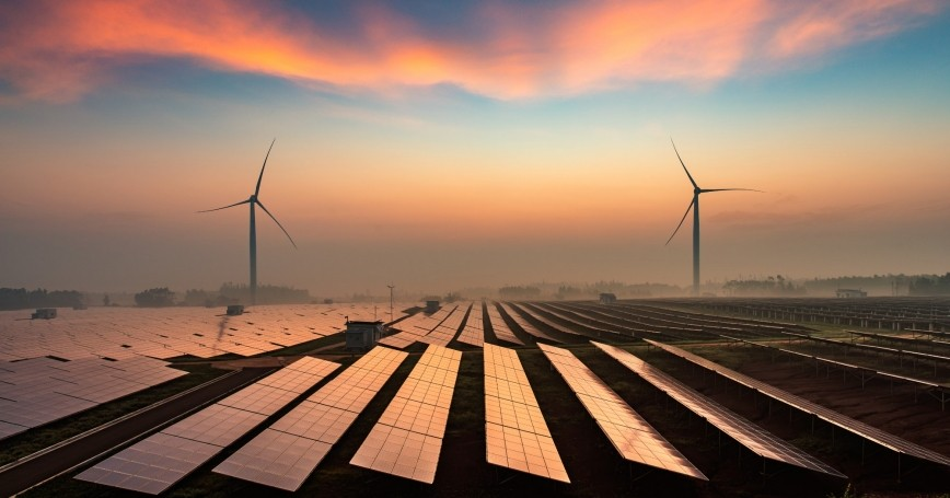Solar and wind farm with sunset and clouds, photo by yangphoto/Getty Images