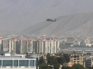 A NATO helicopter flies over the city of Kabul, Afghanistan, June 29, 2020, photo by Omar Sobhani/Reuters