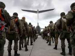 Russian paratroopers line up to board a transport plane during Zapad-2021 military exercises at an aerodrome in Kaliningrad Region, Russia, September 13, 2021, photo by Vitaly Nevar/Reuters