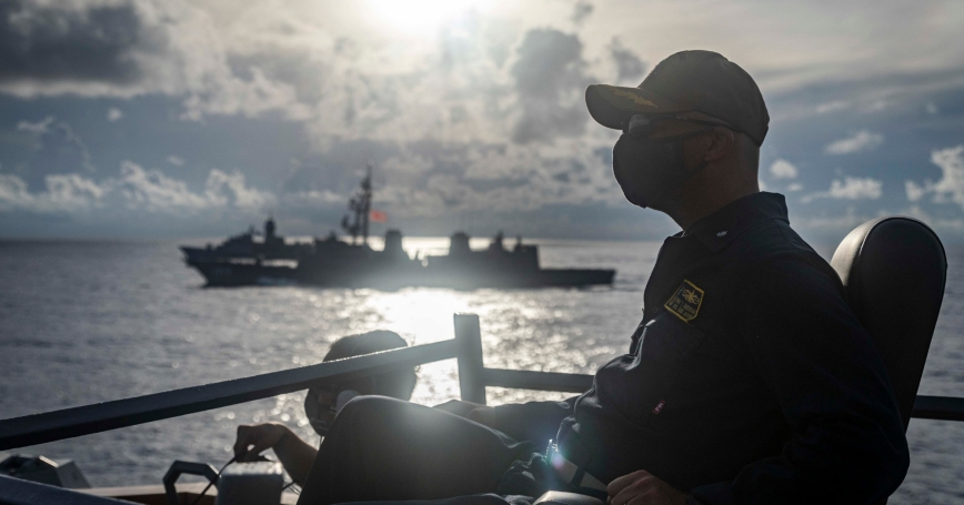 Navy Cmdr. Ryan T. Easterday, commanding officer of the guided missile destroyer USS John S. McCain, observes from the bridge wing as the ship sails in the South China Sea, Oct. 20, 2020, photo by Navy Petty Officer 2nd Class Markus Castaneda/U.S. Department of Defense