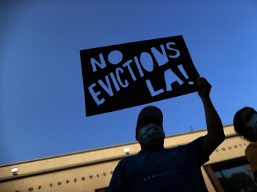 Tenants and housing rights activists protest for a halting of rent payments and mortgage debt in Los Angeles, California, October 1, 2020, photo by Lucy Nicholson/Reuters