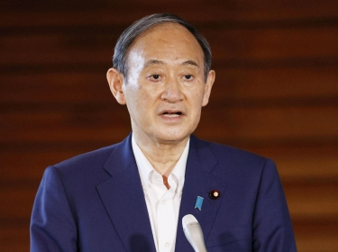 Japan's Prime Minister Yoshihide Suga speaks to media after annoucing his withdrawal from the party leadership race in Tokyo, Japan, September 3, 2021, photo by Kyodo/Reuters