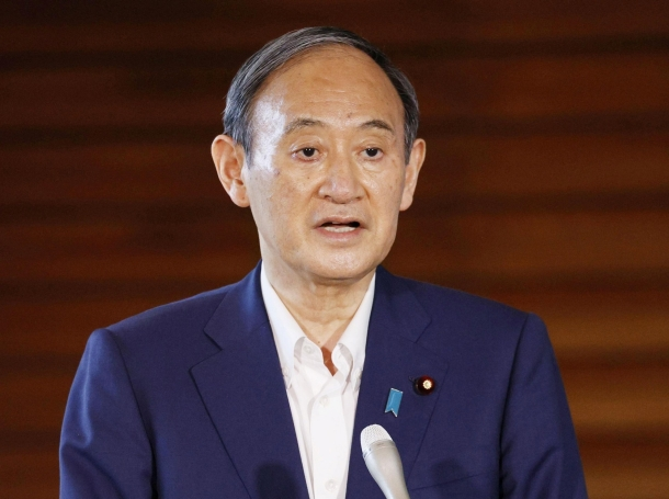 Japan's Prime Minister Yoshihide Suga speaks to media after announcing his withdrawal from the party leadership race in Tokyo, Japan, September 3, 2021, photo by Kyodo/Reuters