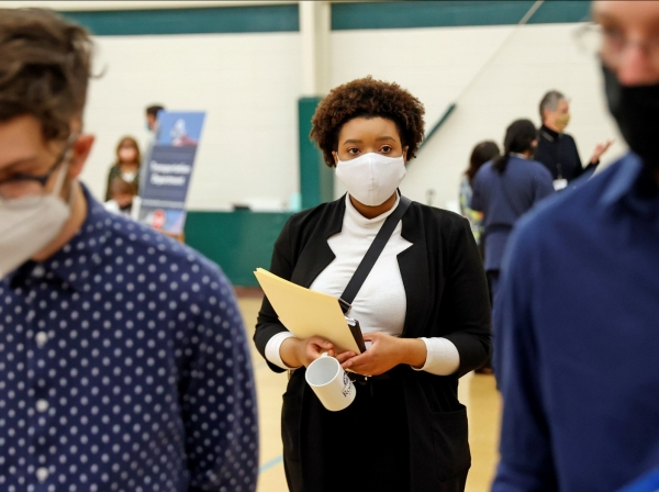 Britni Mann waits to speak with potential employers during a job fair at Hembree Park in Roswell, Georgia, May 13, 2021, photo by Christopher Aluka Berry/Reuters