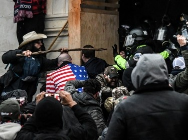 Trump supporters battle with police at the west entrance of the Capitol building in Washington, D.C., January 6, 2021, photo by Stephanie Keith/Reuters