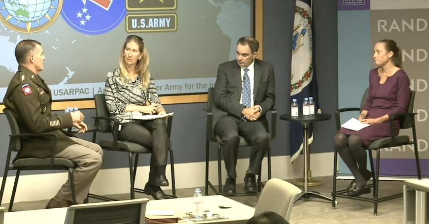 U.S. Gen. Charles Flynn (left) speaks with RAND researchers Jennifer Moroney, Michael Mazarr, and Jennifer Kavanagh at an event at RAND's Washington Office, October 7, 2021, photo by RAND Corporation