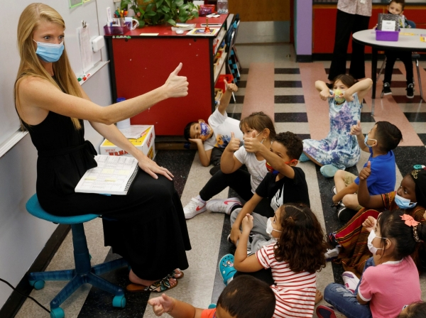 Teacher Emma Rossi works with her first grade students at the Sokolowski School in Chelsea, Massachusetts, September 15, 2021, photo by Brian Snyder/Reuters