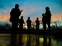 U.S. soldiers gather as the sun sets at Camp Williams, Utah, April 16, 2021, photo by Sgt. 1st Class Brent Powell/U.S. Army