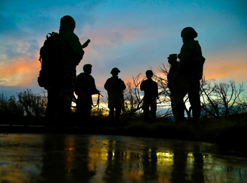 U.S. soldiers gather as the sun sets at Camp Williams, Utah, April 16, 2021