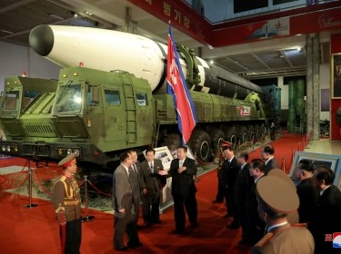 Kim Jong-un speaks to officials at the Defence Development Exhibition, in Pyongyang, North Korea, in this undated photo released on October 12, 2021, photo by KCNA via Reuters