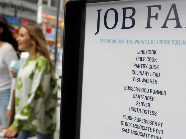 Signage for a job fair is seen on 5th Avenue after the release of the jobs report in New York City, September 3, 2021, photo by Andrew Kelly/Reuters