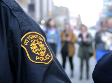 Pittsburgh Police stand with a group of Pitt students